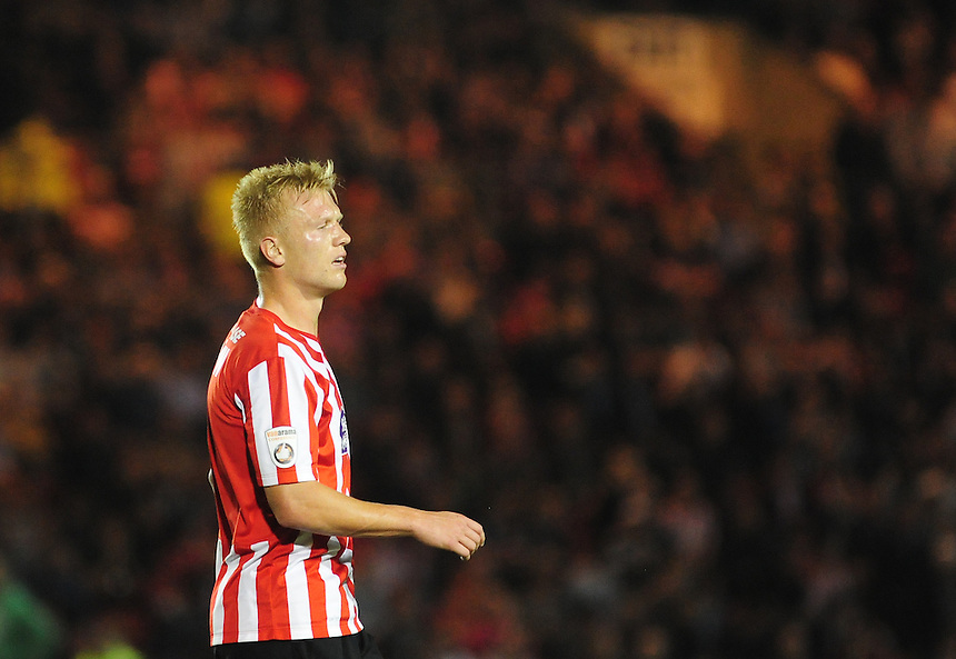 Lincoln City's Jordan Burrow<br /> <br /> Photo by Chris Vaughan/CameraSport<br /> <br /> Football - English Football Vanarama Conference Premier League - Lincoln City v Grimsby Town - Tuesdayb9th September 2014 - Sincil Bank - Lincoln<br /> <br /> &copy; CameraSport - 43 Linden Ave. Countesthorpe. Leicester. England. LE8 5PG - Tel: +44 (0) 116 277 4147 - admin@camerasport.com - www.camerasport.com