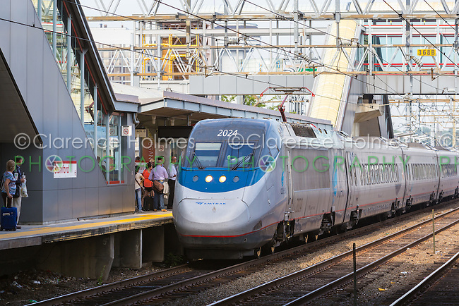 Passengers board a southbound Amtrak Acela Express train in Stamford, Connecticut.