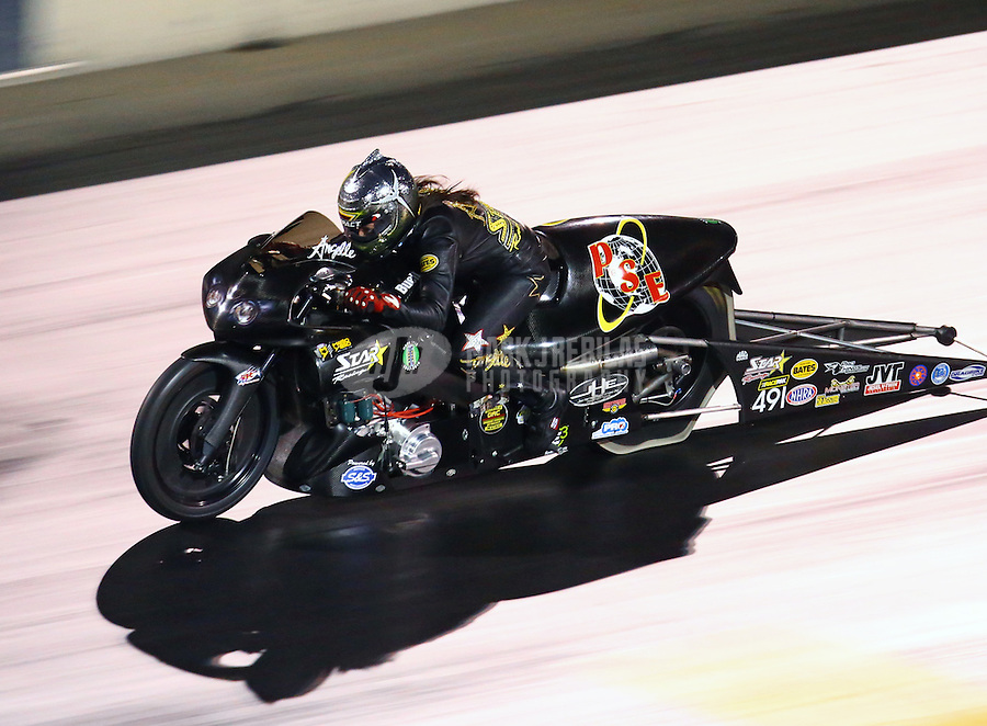 Jul 23, 2016; Morrison, CO, USA; NHRA pro stock motorcycle rider Angelle Sampey during qualifying for the Mile High Nationals at Bandimere Speedway. Mandatory Credit: Mark J. Rebilas-USA TODAY Sports