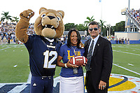 17 September 2011:  FIU Athletic Director Pete Garcia and FIU's mascot, Roary, present a game ball at the end of the first quarter.  The FIU Golden Panthers defeated the University of Central Florida Golden Knights, 17-10, at FIU Stadium in Miami, Florida.