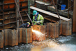 A welder cuts a hole in a cofferdam at the Duboistown Bridge.