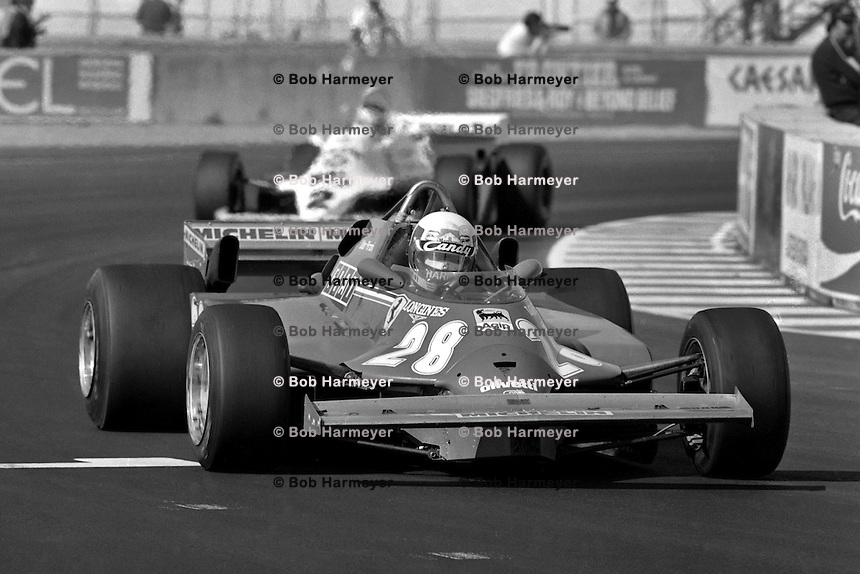 LAS VEGAS, NV - OCTOBER 17: Didier Pironi drives the Ferrari F126CK 049B/Ferrari 021 ahead of Carlos Reutemann in the Williams FW07C 17/Ford Cosworth during the Caesar's Palace Grand Prix FIA Formula One World Championship race on the temporary circuit in Las Vegas, Nevada, on October 17, 1981.