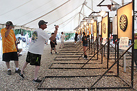 MEGAN DAVIS/MCDONALD COUNTY PRESS Throughout the weekend, darters gather under the white-top tent to practice their shots in hopes of ultimately winning the cash grand prize. The event is open to the public and locals are encouraged to stop by Wayside Campground and take part.