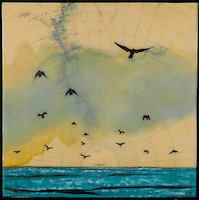 Mixed media photography over antique map of South Pole with birds and blue green ocean.