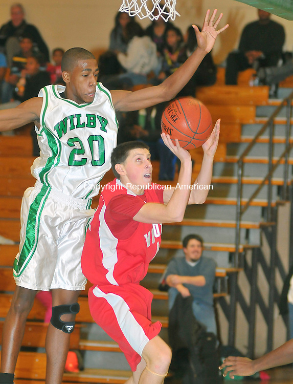 WATERBURY, CT-02 JANUARY 2010-010102JS13- Wolcott's Tyler Pelletier (4)  tries to get off a shot in front of Wilby's Lemar Larsen (20) during their game Saturday at Wilby High School. <br /> Jim Shannon Republican-American