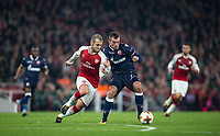 Jack Wilshere of Arsenal battles Nenad Krsticic of Crvena Zvezda (Red Star Belgrade) during the UEFA Europa League group stage match between Arsenal and FC Red Star Belgrade at the Emirates Stadium, London, England on 2 November 2017. Photo by Andy Rowland.