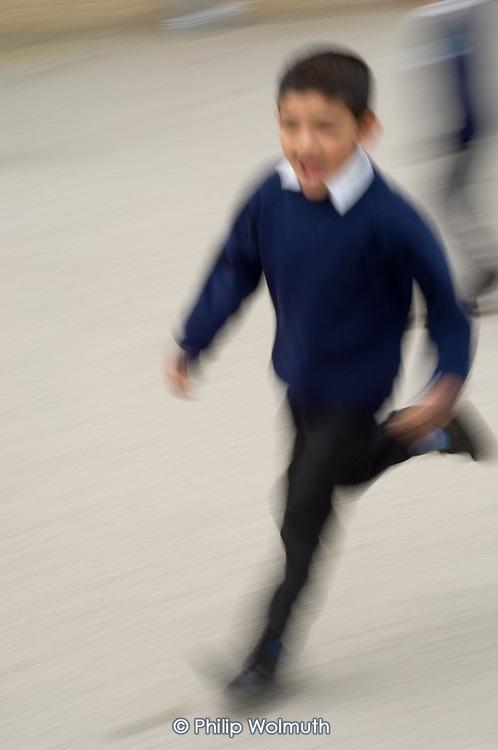 Boy running in a school playground
