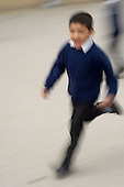 Boy running in a school playground