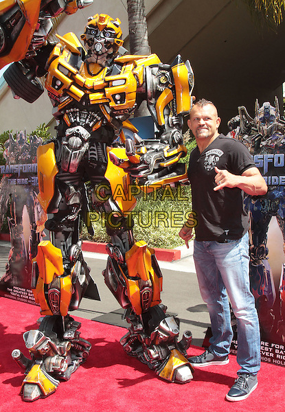 Bumblebee & Chuck Liddell.The World Premiere of Universal Studios Hollywood's 'Transformers: The Ride-3D' held at Universal Studios, Universal City, California, USA..May 24th, 2012.full length black t-shirt jeans denim robot yellow autobot .CAP/ADM/SLP/JO.©James Orken/Starlitepics/AdMedia/Capital Pictures.