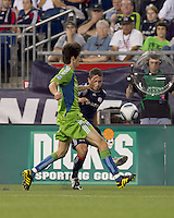 New England Revolution midfielder Chris Tierney (8) crosses the ball as Seattle Sounders FC midfielder Alvaro Fernandez (15) closes. The New England Revolution defeated the Seattle Sounders FC, 3-1, at Gillette Stadium on September 4, 2010.