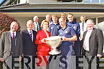 PHOTO OP: Kerry footballers and former ISK students Sean O'Sullivan, Aidan O'Shea and Donnacha Walsh with Kerry County board chairman Jerome Conway showing the President and her husband the Sam Maguire Cup during her visit to the Intermediate School, Killorglin on Thursday.