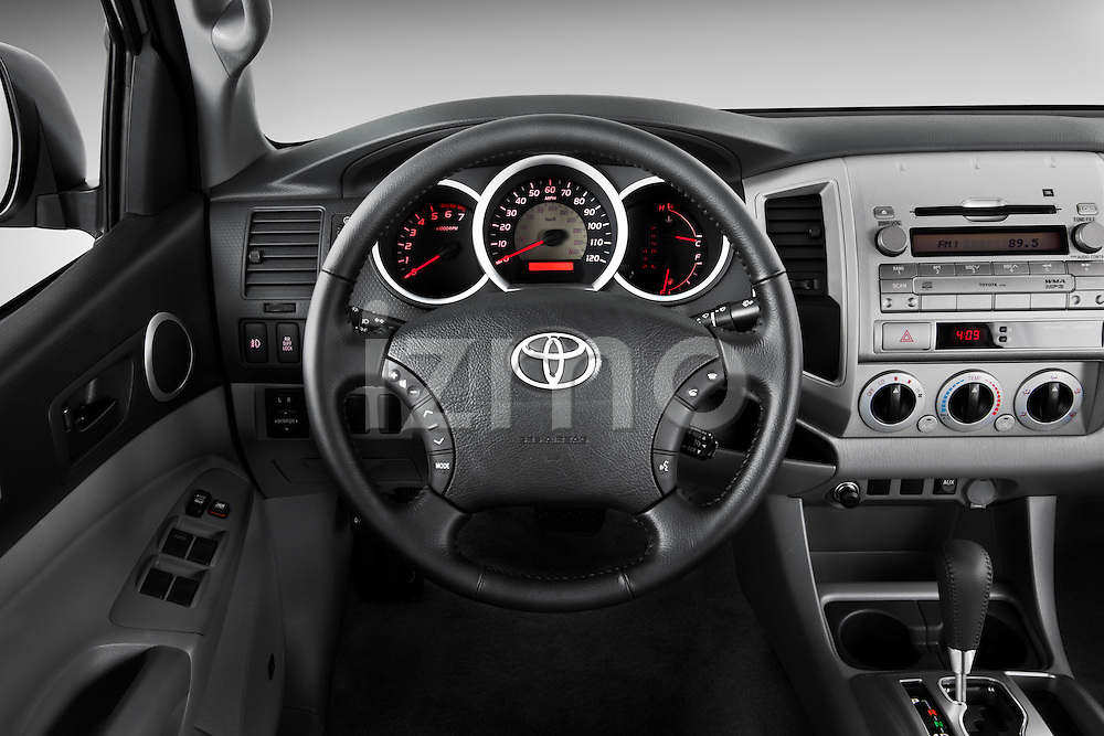 Steering wheel view of a 2011 Toyota Tacoma PreRunner Off Road Double Cab