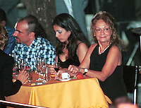 FILE PHOTO/ February/2001. Dalia Soto del Valle (R) talks with their son Alexander (L) and a unidentified friend during the event Habanos SA, in the Tropicana Cabaret, in The Habana. Soto del Valle, 60 years old and she have shared the last 40 years with Fidel Castro. She have to with Castro five children, Alexis, Alex, Alexander, Antonio and Angel. Credit: Jorge Rey/MediaPunch