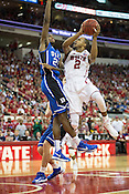 NC State's Lorenzo Brown goes up against Duke's Amile Jefferson, PNC Arena, Raleigh, NC, Jan. 12, 2013.