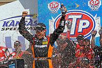 Winner Matt Kenseth, (#20) celebrates in Victory Lane.