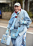 A Manchester City fan makes his way to the stadium before the start of the premier league match at the Stamford Bridge stadium, London. Picture date 30th September 2017. Picture credit should read: Robin Parker/Sportimage