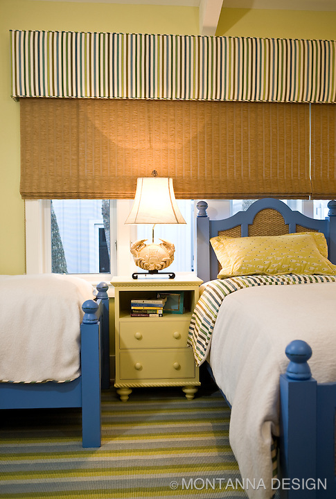 Painted wood furniture for a colorful kid's room makes bunking at the beach fun