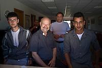 Roma, 13 Giugno, 2013. Padre Gaetano Greco, cappellano del carcere minorile di Casal del Marmo a Roma, con due ragazzi ospiti del suo centro di recupero per minori.