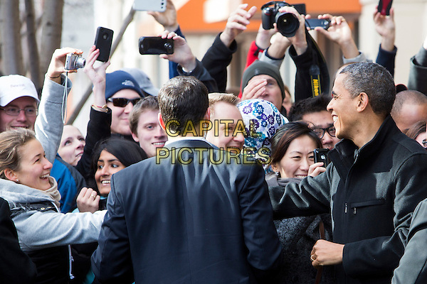 United States President Barack Obama, center, and daughters Sasha, left, and Malia, right, shop in Arlington, Virginia on Small Business Saturday, .November 24th, 2012 .half length black jacket fans crowd profile shaking hands .CAP/ADM/CNP/KT.©Kristoffer Tripplaar/CNP/AdMedia/Capital Pictures.
