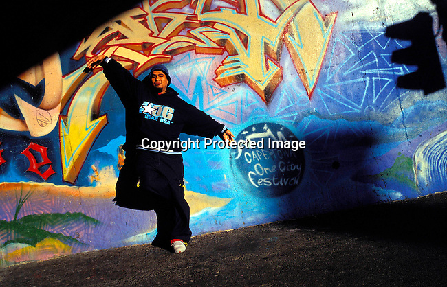 dienvgr00028 Graffiti artist SKY 189 , Evaron Orange in front one of his art works on September 5, 2002 in downtown Cape Town, South Africa. .©Per-Anders Pettersson/iAfrika Photos