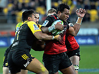 Seta Tamanivalu is wrapped up during the Super Rugby match between the Hurricanes and Crusaders at Westpac Stadium in Wellington, New Zealand on Saturday, 15 July 2017. Photo: Dave Lintott / lintottphoto.co.nz