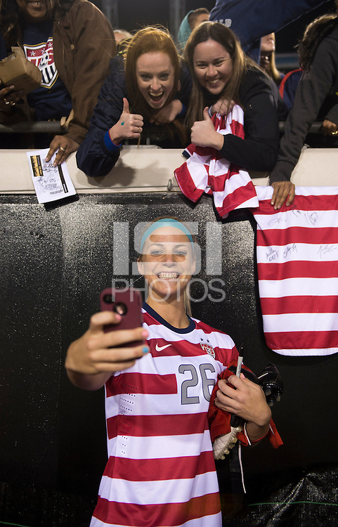 Julie Johnston (26) of the USWNT takes a photo with fans after the game during the game at EverBank Field in Jacksonville, Florida.  The USWNT defeated Scotland, 4-1.