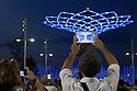 A visitor of Expo 2015 films with his tablet the spectacle of the Tree of Life at the Lake Arena, Rho-Pero, Milan, in June 2015. The Tree of Life is the symbol of the Italian pavilion. &copy; Carlo Cerchioli<br /> <br /> Una visitatore di Expo 2015 riprende con il suo tablet lo spettacolo dell'Albero della vita alla Lake Arena, Rho-Pero, Milano, giugno 2015. L'albero della vita &egrave; il simbolo del padiglione Italia.