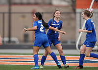 NWA Democrat-Gazette/BEN GOFF @NWABENGOFF<br /> Leslie Barrales (from left), Haley Arrick and Sienna Nealon of Rogers celebrate after Barrales scored against Rogers Heritage Friday, March 17, 2017, during the game in Gates Stadium at Rogers Heritage.