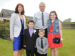 Kyle Callaghan who received First Holy Communion in St. Cianan's church Duleek pictured withparents Aidan and Sonia, brother Glen and sister Rebecca. Photo: Colin Bell/pressphotos.ie
