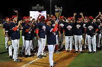 Manager Darren Fenster holds up the trophy as Greenville Drive players celebrate their 2017 South Atlantic League Championship following an 8-3 win over the Kannapolis Intimidators in Game 4 of the Championship Series on Friday, September 15, 2017, at Fluor Field at the West End in Greenville, South Carolina. It was Greenville's first SAL Championship. Greenville won the series 3-1. (Tom Priddy/Four Seam Images)