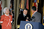 United States President George H.W. Bush and first lady Barbara Bush present the Presidential Citizens Medal to the Vice Chairman of the Joint Chiefs of Staff, US Navy Admiral David Jeremiah during a ceremony in the East Room of the White House in Washington, DC on July 3, 1991. Admiral Jeremiah is being honored for his efforts to ensure the success of Operation Desert Shield / Operation Desert Storm and the liberation of Kuwait.<br /> Credit: Ron Sachs / CNP
