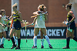 Jule Grashoff (rear) of the Wake Forest Demon Deacons gets a hug from teammate Emily Adamson (9) after scoring a goal against the Michigan Wolverines during second half action at Kentner Stadium on August 28, 2016 in Winston-Salem, North Carolina.  The Demon Deacons defeated the Wolverines 2-0.  (Brian Westerholt/Sports On Film)