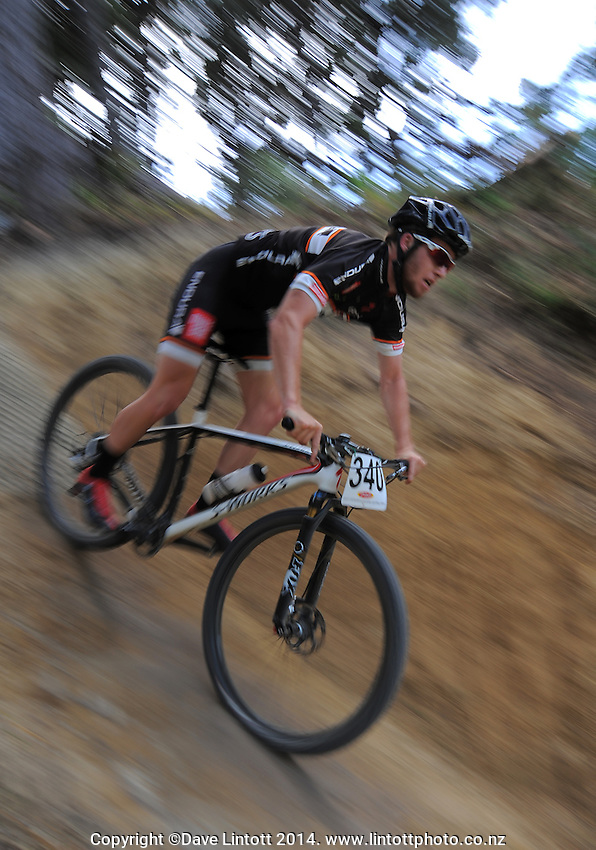 Jack Compton in action during the first round of the 2014 New Zealand National Cross-country Mountainbiking Championships at Mount Victoria, Wellington, New Zealand on Sunday, 19 January 2014. Photo: Dave Lintott / lintottphoto.co.nz