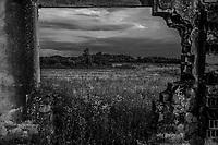 A view through remains of a house in a Muslim village where war crimes happened near Kozarac June 28, 2018.
