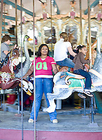 Tyra Roberts and Shannon Thompson on Pullen Park's craousel.