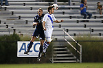 01 October 2013: Duke's Rob Dolot (24) heads the ball away from UNCW's Nathaniel Goodwin (21). The Duke University Blue Devils hosted the University of North Carolina Wilmington Seahawks at Koskinen Stadium in Durham, NC in a 2013 NCAA Division I Men's Soccer match. UNCW won the game 2-1.