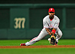 28 September 2010: Philadelphia Phillies' infielder Jimmy Rollins makes a play on a sharp grounder during game action against the Washington Nationals at Nationals Park in Washington, DC. The Nationals defeated the Phillies 2-1 on an Adam Dunn walk-off solo homer in the 9th inning to even up their 3-game series one game apiece. Mandatory Credit: Ed Wolfstein Photo