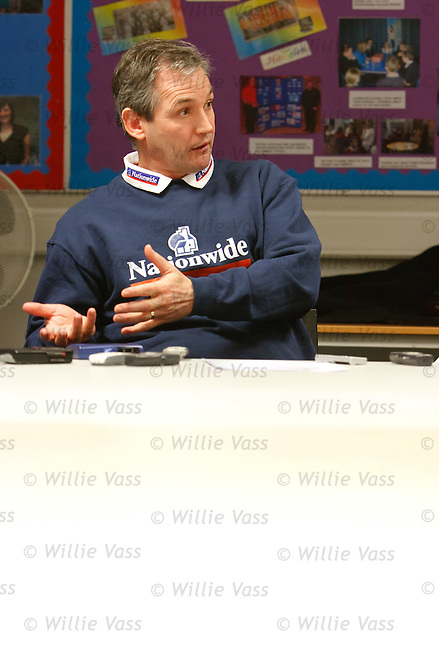 George Burley speaking in a classroom at a Nationwide coaching session at Graham High School, Falkirk