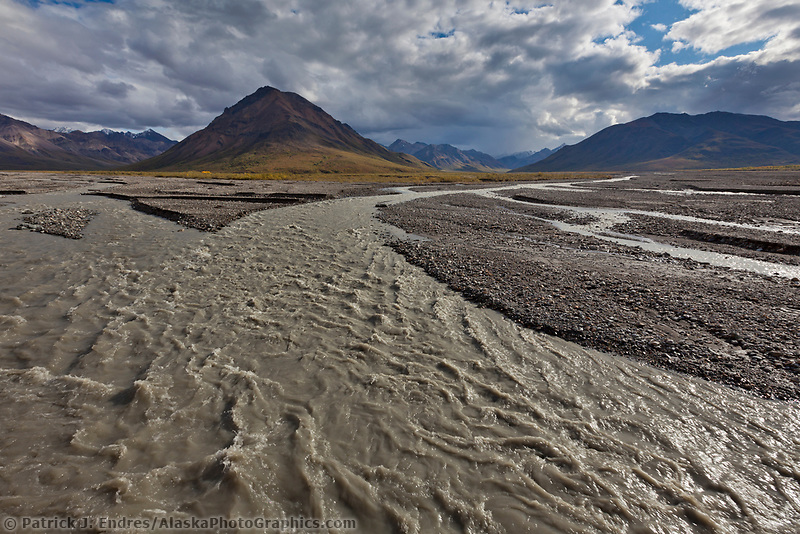 Gray water flows in the Toklat River, fed from melting glaciers in the Alaska Range mountains, Denali National Park, Interior, Alaska.