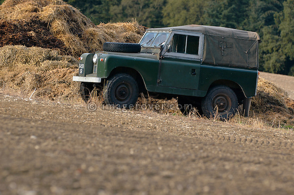 Very original 1962 Land Rover 88 Series 2a SWB 4cyl petrol in faded dark bronze green paint on a field in southern England. Europe, UK, England, Hampshire. --- Car / Property release available. Automotive trademarks are the property of the trademark holder, authorization may be needed for some uses.