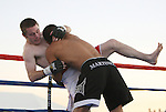 Devin Conkling is taken down by Vincent Martinez in a mixed martial arts bout.   Photo by Tom Smedes.