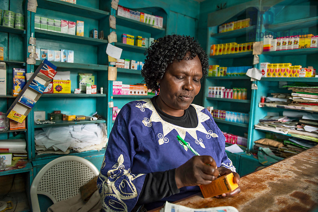 June 22, 2016; Hilda Makokha works behind the counter at Earl Pharmacy in Dandora, Kenya.  (Photo by Barbara Johnston/University of Notre Dame)