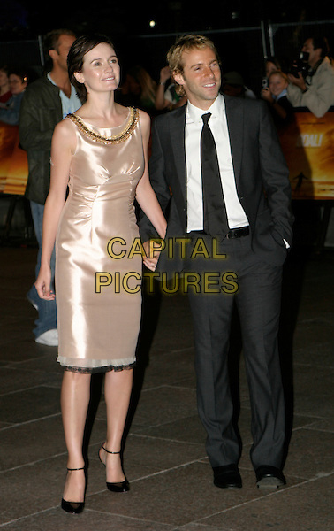 EMILY MORTIMER & ALESSANDRO NIVOLA.At The Goal Film Premiere held at the Odeon Cinema,.Leicestre Square,.London, 15th September 2005.full length grey gray suit dark cream satin dress black lace trim mary jane shoes.Ref: AH.www.capitalpictures.com.sales@capitalpictures.com.© Capital Pictures.