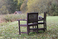 General view of a wooden seat overlooking Lake of Menteith.