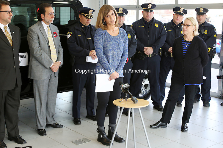 CHESHIRE CT. 08 December 2015-120815SV02-Pam Bingman of Cheshire, whose brother was killed by a drunk driver, speaks at a press conference by Mothers Against Drunk Driving at Richard Chevrolet in Cheshire Tuesday. MADD was announcing their &ldquo;Tie One On For Safety&rdquo; holiday campaign. Janice Heggie Margolis, executive director MADD, at right.<br /> Steven Valenti Republican-American