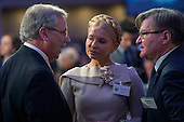 Former Prime Minister Yulia Tymoshenko of Ukraine, center, speaks with other guests prior to the National Prayer Breakfast in Washington, DC, USA, 04 February 2016. For 63 years the National Prayer Breakfast has given presidents the opportunity to gather with members of Congress and evangelical Christians to pray and talk about the role of prayer in their own lives.<br /> Credit: Shawn Thew / Pool via CNP