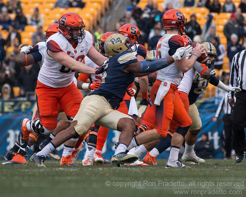 Pitt defensive end Ejuan Price sacks the quarterback. The Pitt Panthers defeated the Syracuse Orange 76-61 at Heinz Field in Pittsburgh, Pennsylvania on November 26, 2016.