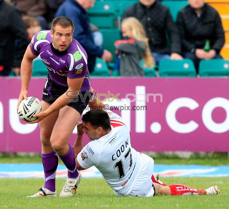 PICTURE BY CHRIS MANGNALL /SWPIX.COM...Rugby League - Super League  -  Hull Kingston Rovers v Bradford Bulls  - Craven Park, Hull, England  - 15/05/11... Hull KR's  Matt Cook tackles Bradford's Andy Lynch