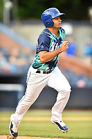 Asheville Tourists Coco Montes (5) runs to first base during a game against the Greenville Drive on Hippie Night at McCormick Field on July 11, 2019 in Asheville, North Carolina. The Drive defeated the Tourists 6-2. (Tony Farlow/Four Seam Images)