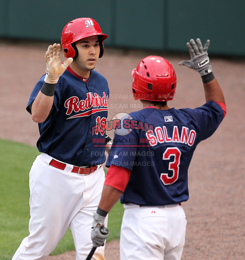 Memphis Redbirds catcher Tony Cruz #18 is congratulated by Donovan Solano #3 after hitting a home run during a game versus the Round Rock Express at Autozone Park on April 30, 2011 in Memphis, Tennessee.  Memphis defeated Round Rock by the score of 10-7.  Photo By Mike Janes/Four Seam Images